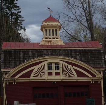The tiny doors, the moldings and the cupola combine to make a pretty impressive garage.