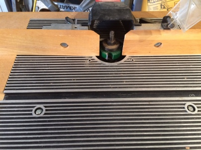 This is a Rabbit cutter mounted in my shaper. The fence provides support for the workpiece and the bearing on top of the cutter controls the depth of the cut.