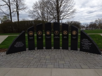 """The front of each stone bears the motto of the service represented by the stone. The last stone ends with """"All gave some. Some gave all."""""""