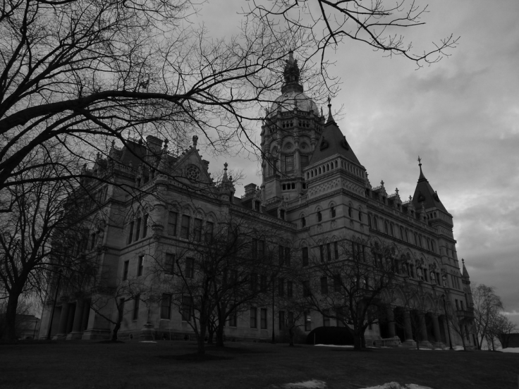 The Capitol Building sits on a small hill that rises above Bushnell Park in Hartford.