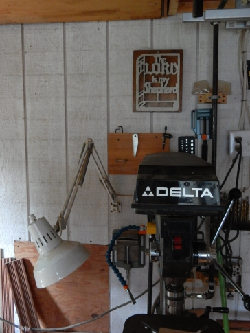 Delta drill press with my plaque hanging behind it
