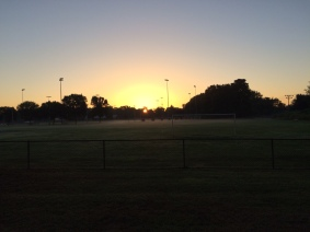 Sunrise behind the ball fields in Veteran's Park