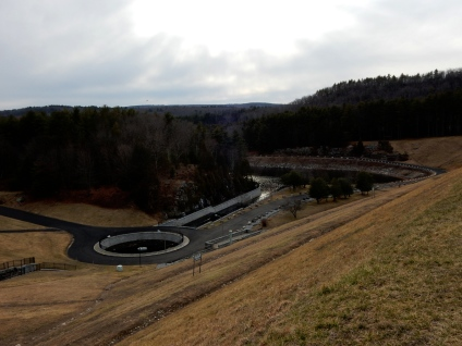 The grassy area is the face of the dam.