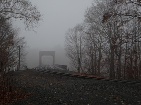 Foggy railroad bridge