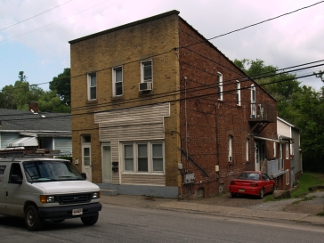 It's not much to look at, but this place was full of love. My grandmother lived in the front 1st fl apartment. We lived on both floors of the back half and my favorite Aunt Adel lived in that house in the back. The non-brick area is because it used to be a store.