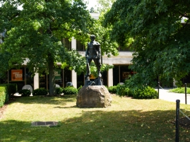 The Mountaineer, with the entrance to the bookstore behind him. Now run by Barnes and Nobel :(