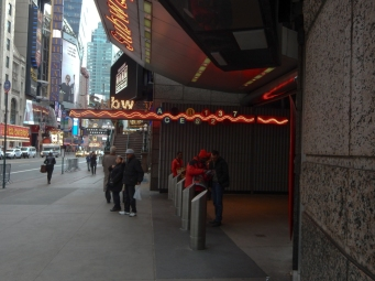 Even the subway entrance on Broadway has a touch of neon,