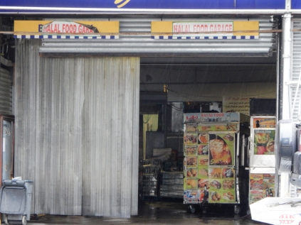 This garage is one of the places that they store the street vendor carts.