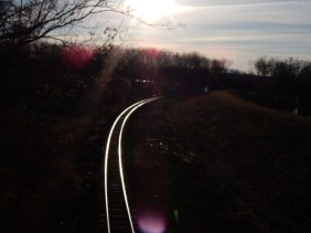 Sunrise over Riverside Park rails along the levee.