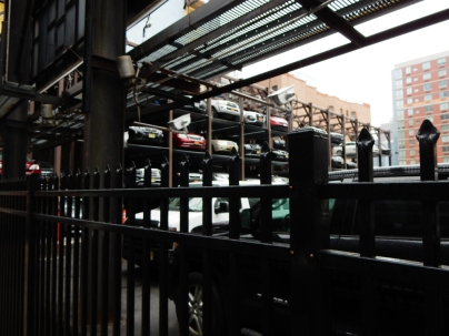 No doors, except on the cars. I thought I'd share a photo of one of these garages. Drive it is, stack it up.