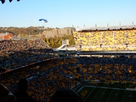 Precision parachute team landing during pre-game activities