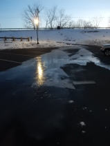 Melt water in the parking lot