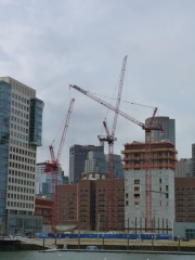 These cranes are hard at work near the waterfront in Boston.