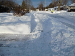 """This is what 20""""(50.8cm) of snow looks like after the plow clears the street."""