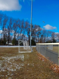 The goals are waiting for spring and children and soccer balls.