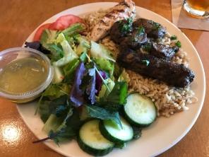 Aladdin's Favorite Combo beef kafta, shish kabob and chicken tawook served ona bed of seasoned white rice
