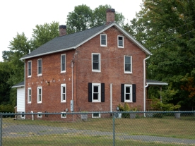 This appears to be/have been a residence. It sits across the sports fields from the main campus buildings