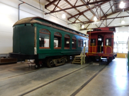 Two of the train cars that have been restored and are on display in the museum