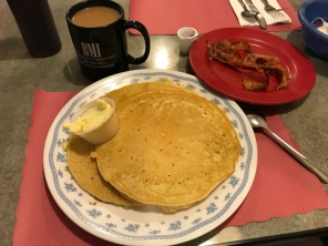 Pancakes and bacon at Maddie's. That's a normal size dinner plate.