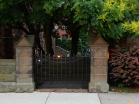 Gate controlling access to the right-side lower-level garden.