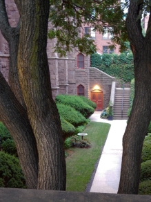 That door is at the back of the church in the lower-level garden on the right side of the church