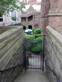 Gate blocking access to the left side lower-level garden.