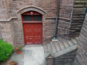 Door to the lower level at the front of the church