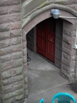 This door is under the side entrance to the sanctuary, on the east side of the church.