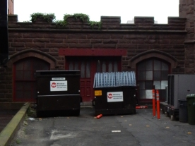 I wish I could move the dumpsters, because that's a really pretty door back there.