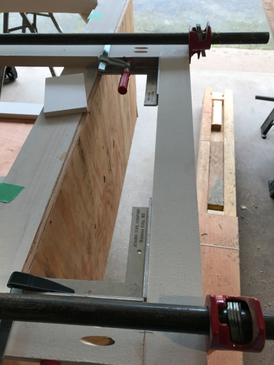 The clamps hold this door frame together while the biscuits and glue are setting up. Once the pocket screws go in, the clamps come off.