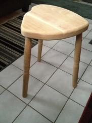 Simple three-legged stool.