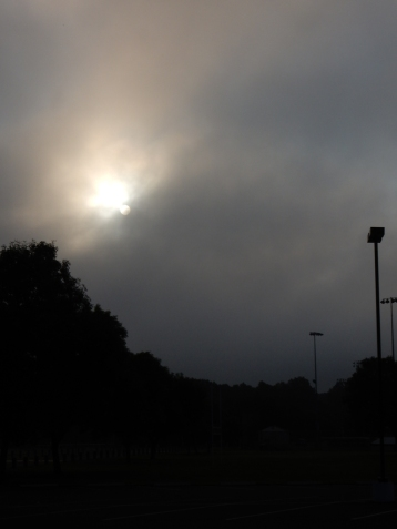 Very dark at the ball field. No, it's not an eclipse, very heavy fog.