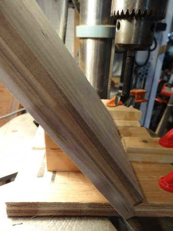 Drilling a stopped, wide hole will provide a finger pull for a slide-out shelf.