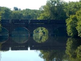 A train, a bridge, a river and a reflection - happy day.