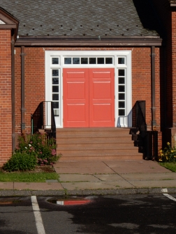 Modern doors, but made to fit in with the neighborhood style.