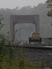 Workmen heading across the river on the railroad bridge