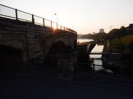 Sun rising over the stone arch bridge. They have re-suppied the old canals, which run through the ruins, with water