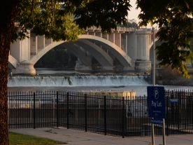 New arch bridge across the Mississippi River and the waterfalls that used to power the flour mills