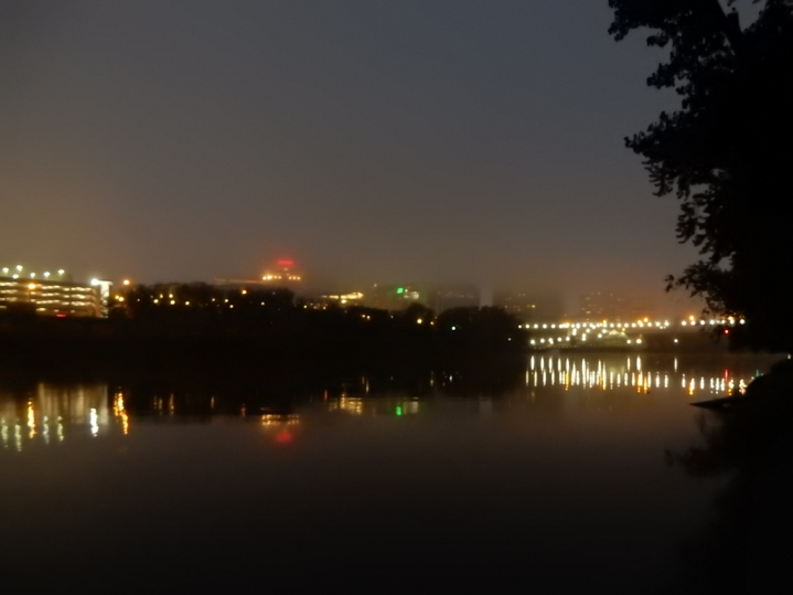 There are some taller buildings than the one we can see here. the lights on the right are a bridge