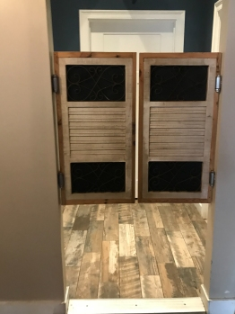 The restrooms are behind the swinging doors.