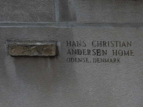 "A piece of the Hans Christian Andersen Home - ""here, let us just chisel that out."""