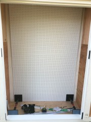 """""""Third Hands"""" are holding the pegboard in at the bottom. I held and screwed the pegboard from the bottom, working my way up."""