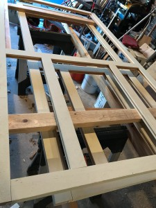 This is a little confusing, because there are two doors here. The frames are light enough to move easily, so I'm stacking them to conserve space as I dry fit the components.