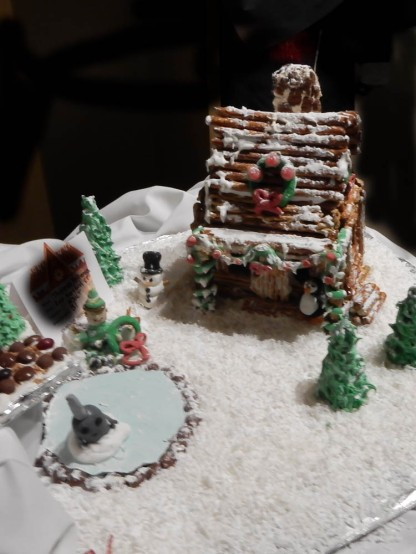 Log cabin and a couple of snowmen.
