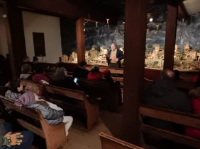 In the Meeting House at Old Sturbridge Villiage - listening to Mathew's account of the first Chistmas.