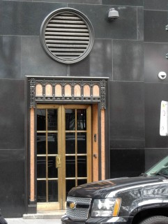 I like the way the main entrance is echoed in the details of this side door.