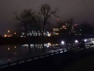 Hartford, seen over and reflected in a frozen Great River Park. The park is closed.