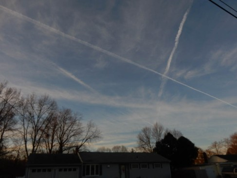 Criss-crossing contrails.