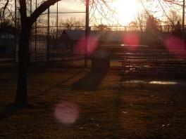 Sunrise over an empty ball field