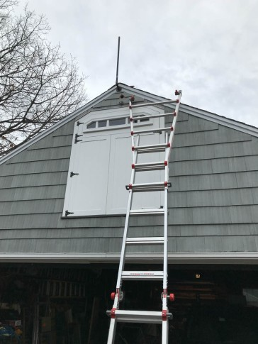 The support pole is anchored. I moved the ladder to get onto the roof and install the sensor.